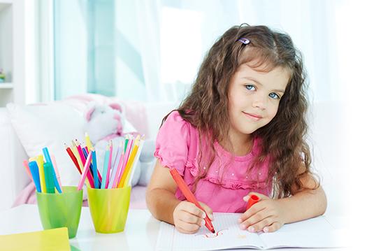 girl drawing smiling
