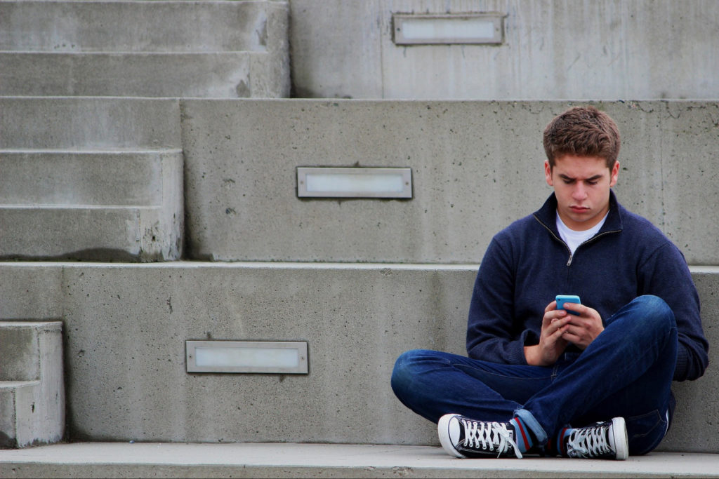 Teenage boy on mobile phone